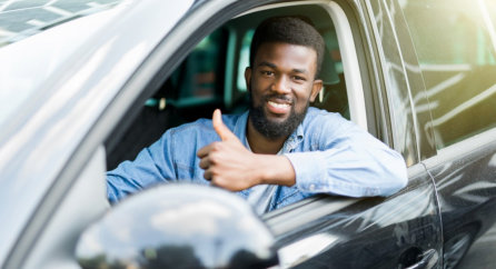 driver showing a thumbs up