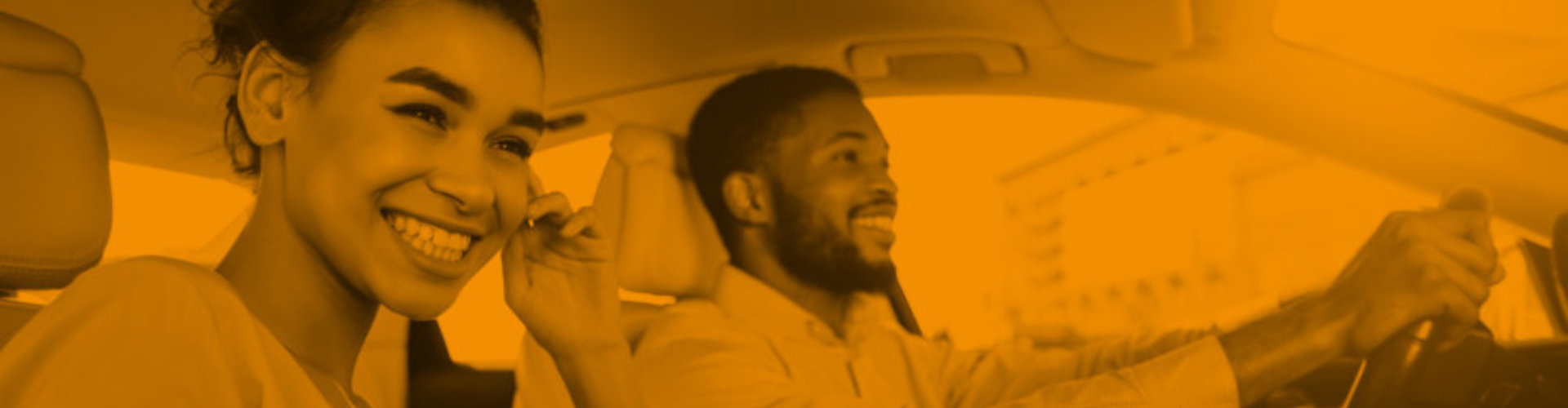 woman and man smiling inside car